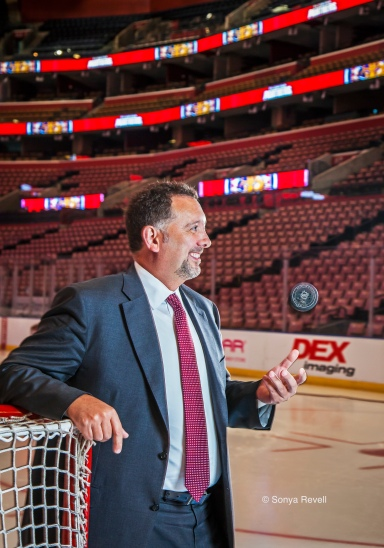 Portrait of Rory Babich CEO of Florida Panthers with hockey puck at BBT Center