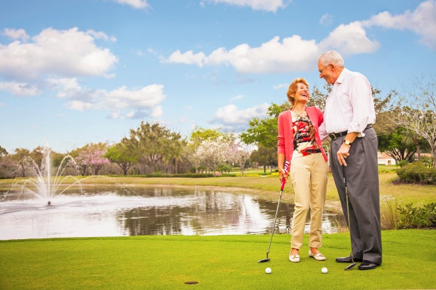 lifestyle-photography-of-senior-couple-golfing-in-naples-florida-with-fountain-in-background