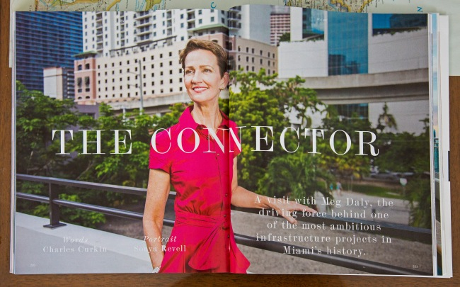 portrait photo of meg daly in pink dress standing in front of brickell skyline