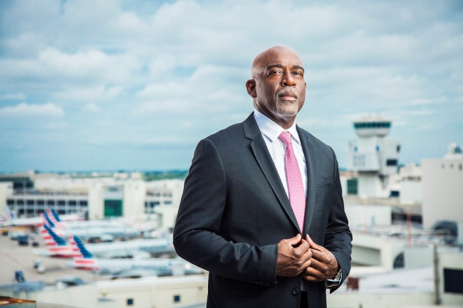 portrait photo of maurice jenkins wearing suit at miami airport