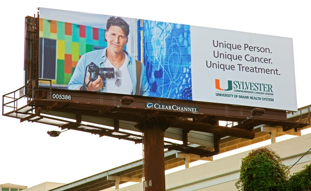 Uhealth Sylvester Advertising billboard featuring portrait of photographer in wynwood holding camera