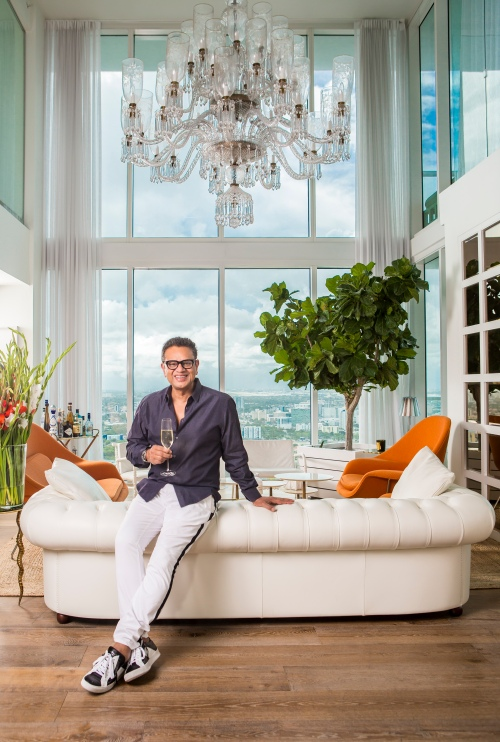 portrait photography of naeem khan in his living room