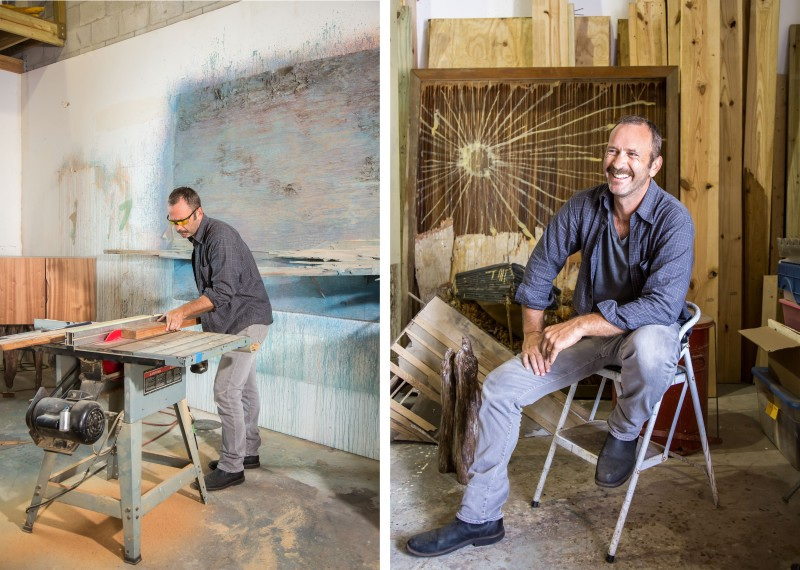 portrait of Phillip Estlund, at his wood-working studio with his raw wood materials