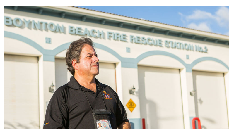 portrait of Luis Garcia in front of the Boynton Beach fire station for GoFundMe