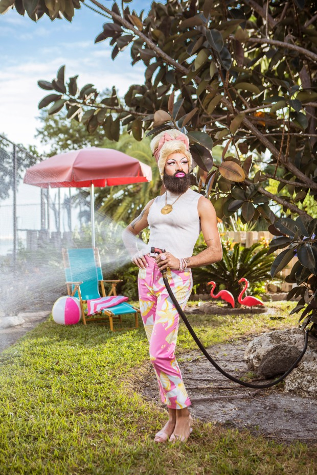 photo of a drag queen watering the lawn