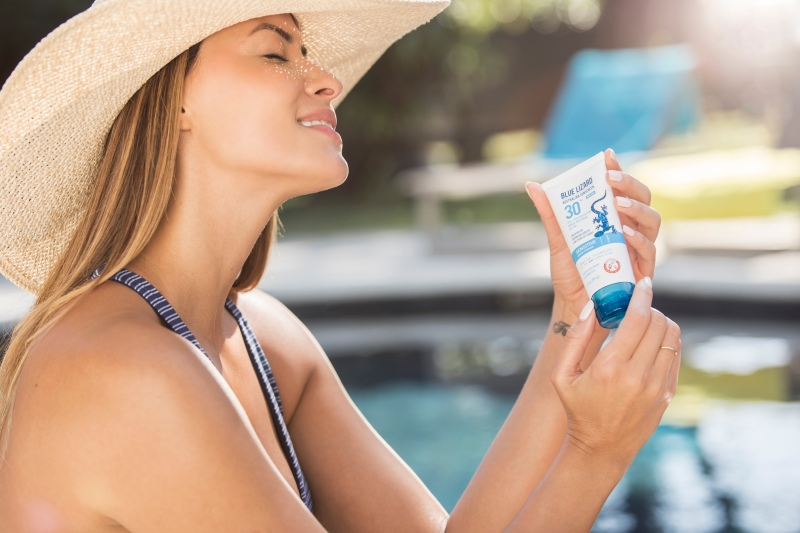 photo of a model holding blue lizard sunscreen