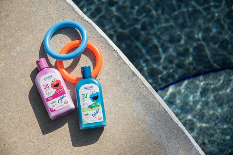 photo of Blue Lizard sunscreen laying by a pool